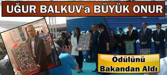Uğur Balkuv'a Bakan Sarıeroğlu'ndan Teşekkür Plaketi